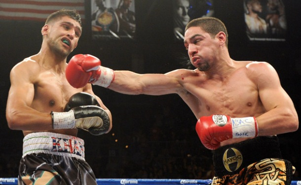 Danny Garcia (right) tags Amir Khan flush with a right hand during their July 14 world title bout Image Credit: Chris Hutty, Hogan Photos, Golden Boy Promotions