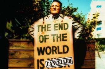 Man wearing sandwich board sign on street. Image Credit: Getty Images/Alan Powdrill