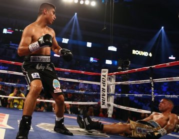 Mikey Garcia (left) knocks out Juan Manuel Lopez in the fourth round of their June 15 featherweight bout from Dallas, Texas (Image Credit: Tom Pennington/Getty Images).