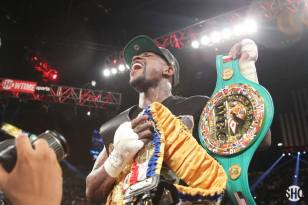 "Floyd Mayweather Jr. celebrates with his unified WBC and WBA super welterweight titles after defeating Saul ""Canelo"" Alvarez on Sept. 14 (Tom Casino/SHOWTIME)."