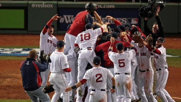 The Boston Red Sox celebrate their Game 6 clincher, and their third World Series title since 2004 (photo: Nancy Lane / Boston Herald).