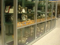 Rudi Carcacciola's Trophies: This whole shelf holds the awards, trophies and commemorative statues that Rudi Caracciola won, including his wins from 1930s Grand Prix.