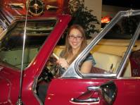 Sitting in a classic Studebaker on display for visitors!