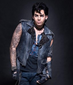 "Adam appears as Eddie in Fox's ""Rocky Horror Picture Show"" [Credit: Fox Entertainment]"