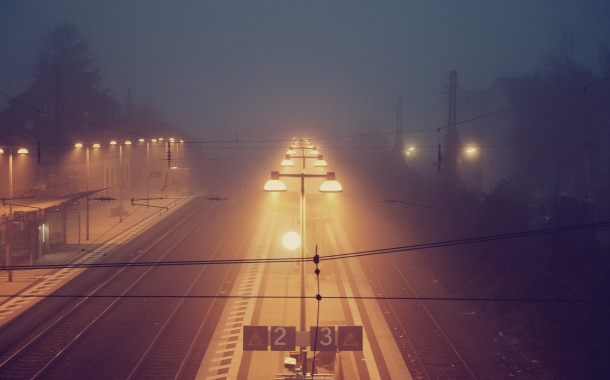 train station railway tracks fog