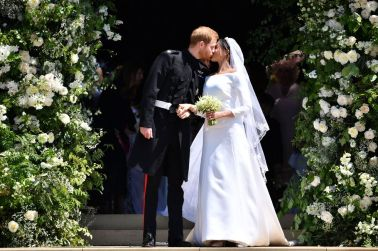 Prince Harry and Meghan Markle mark their first official kiss as husband and wife.